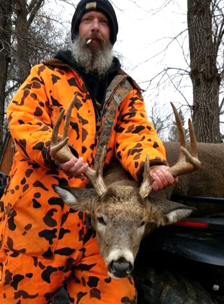 Large whitetail buck attracted using Buck Magic